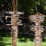 """Stick Totems"" (<a href='/inquire.php?gallery=sculpture&file=stick_totems_8.jpg&caption=Stick Totems'>Inquire about this piece</a>)<br />info: steel wood / 8'"